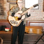 "Regan McCarthy with Buddy Holly guitar at Songmasters & PJ Clarke's ""True Love Ways"" Event"