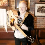 "Peter Asher presented with Buddy Holly guitar at Songmasters & PJ Clarke's ""True Love Ways"" Event"