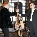 "Peter Asher presented with Buddy Holly guitar at ""True Love Ways"" Songmasters & PJ Clarke's Event"